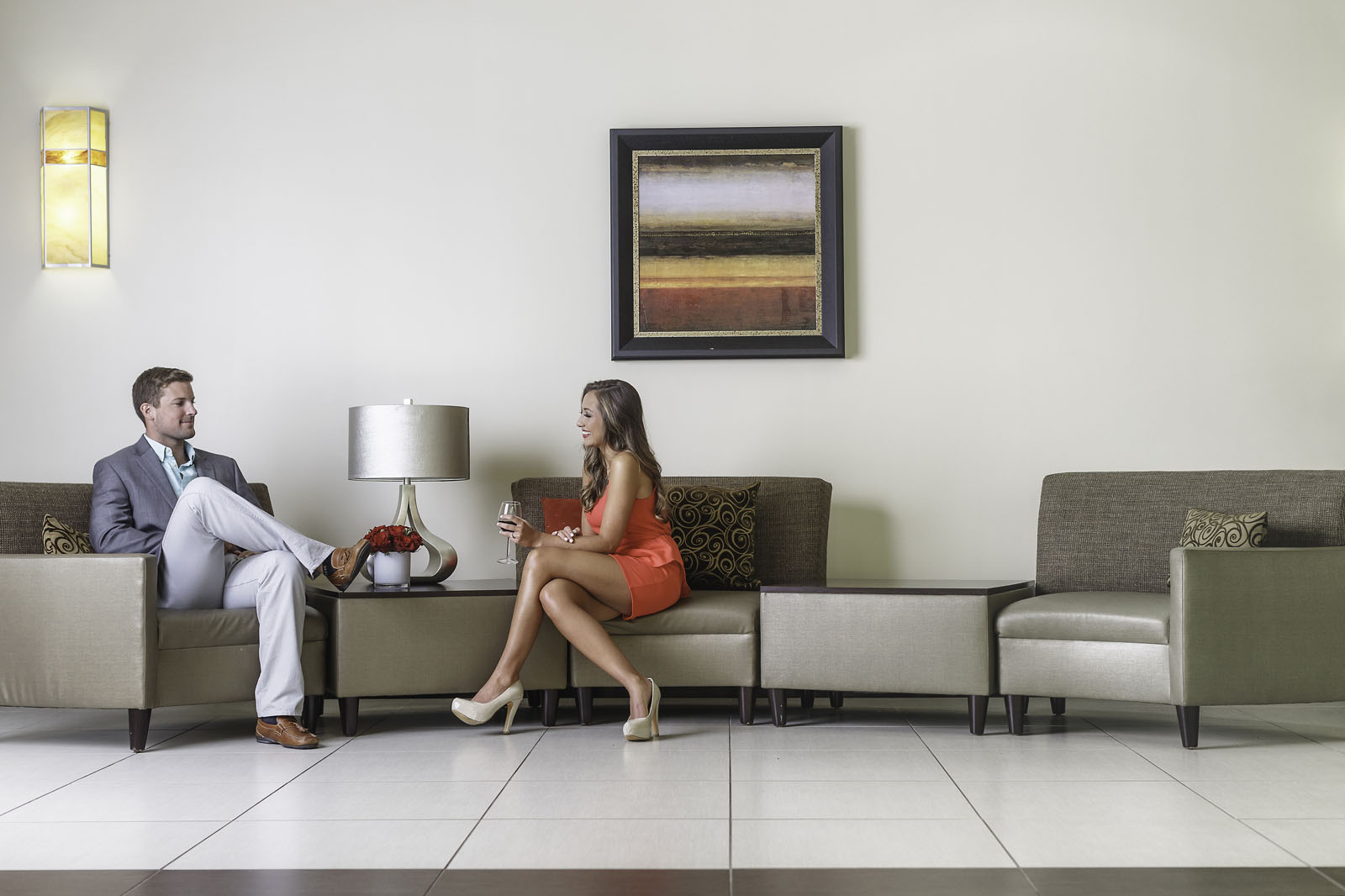 A couple enjoys a drink in the lobby at Hotel Capstone
